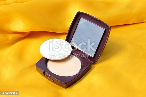 istock cosmetic powder on the white background 474858032