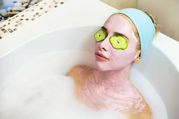 cosmetic procedures and recreation - gurkenmaske stock-fotos und bilder