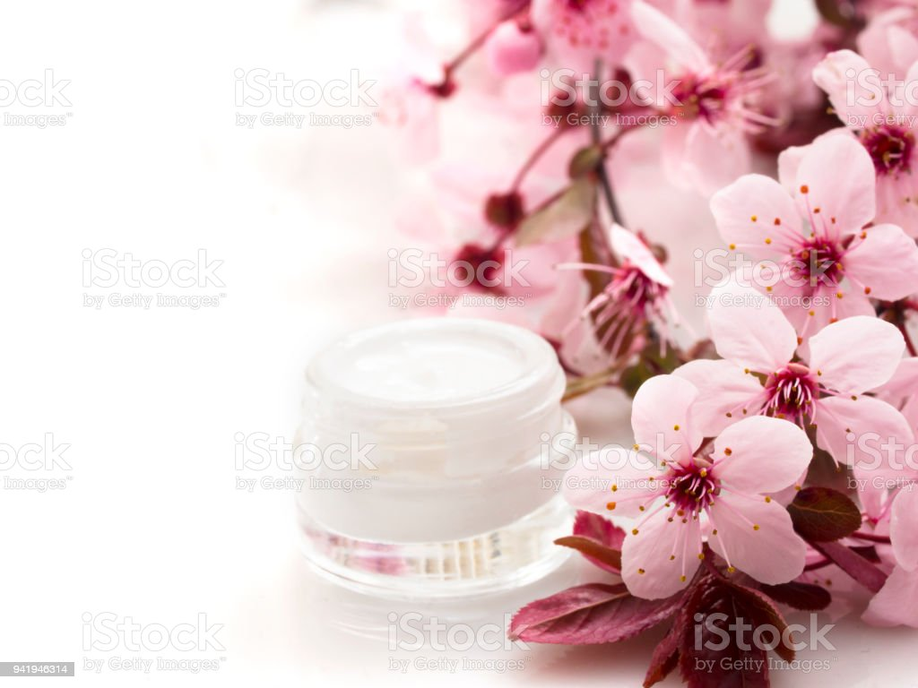 cosmetic product with spring flowers stock photo