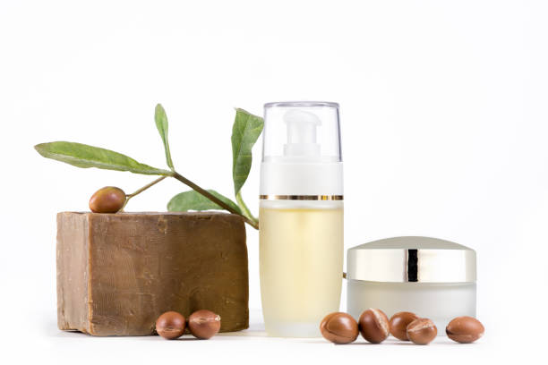 Cosmetic products and argan fruits - foto stock