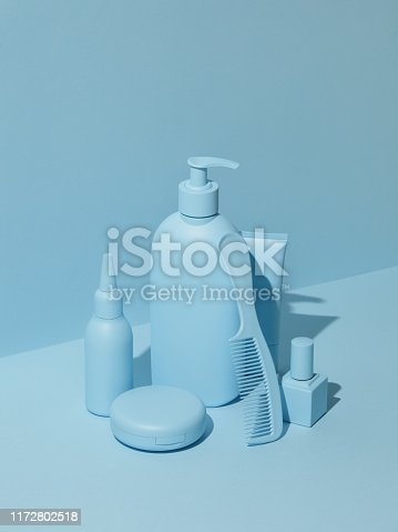 Group of cosmetic products in monochrome blue color
