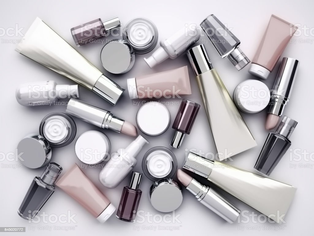 Cosmetic products, lipstik and perfume on gray background. Top view. stock photo
