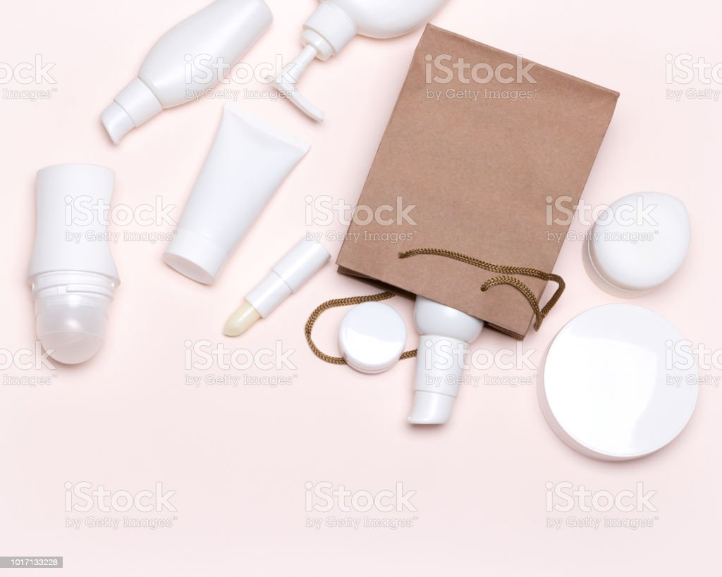 Cosmetic products with paper bag - beauty shopping concept flat lay stock photo
