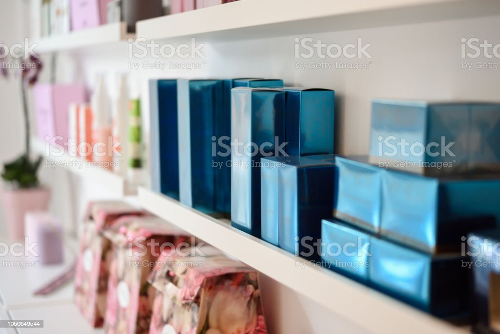 Cosmetic section with facial cream in beauty salon stock photo