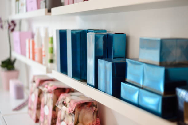 Cosmetic section with facial cream in beauty salon Cosmetic section with facial cream, conditioners, shampoo and hair treatment in store for sale stock pictures, royalty-free photos & images