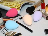 Cosmetic sponge for applying cosmetics on the face. Pink color.