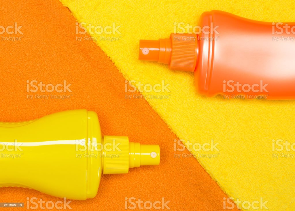 Cosmetic sunscreen products on terry towels stock photo