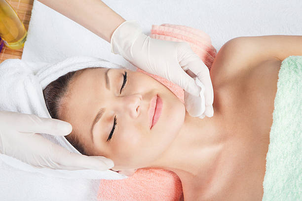 cosmetic treatment at spa salon Cosmetologist medical gloves is touching girl's face.  peel plant part stock pictures, royalty-free photos & images