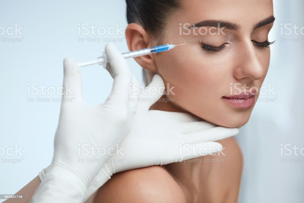 Cosmetic Treatment. Facial Skin Lifting Injection To Woman Face - Royalty-free Acid Stock Photo