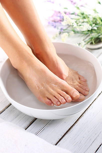 cosmetic treatment, pedicure - drenched stock pictures, royalty-free photos & images