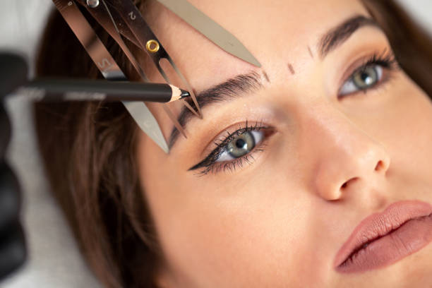 Cosmetician preparing to make a legit appearance of naturally full brows Cosmetician preparing to make a legit appearance of naturally full brows on the face of a pretty young woman always stock pictures, royalty-free photos & images