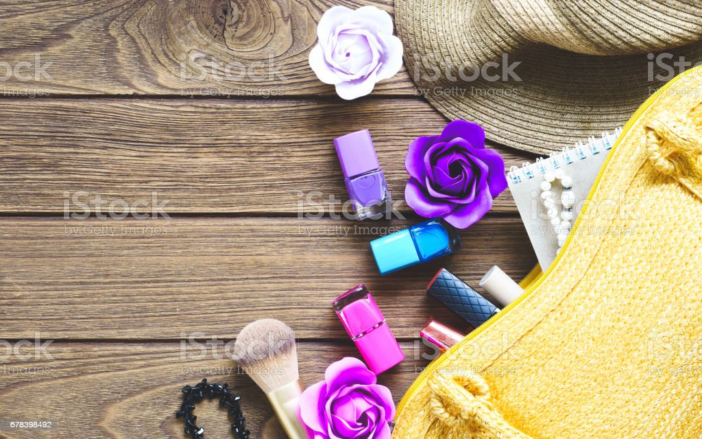 Cosmetics and Accessories from open lady handbag. stock photo