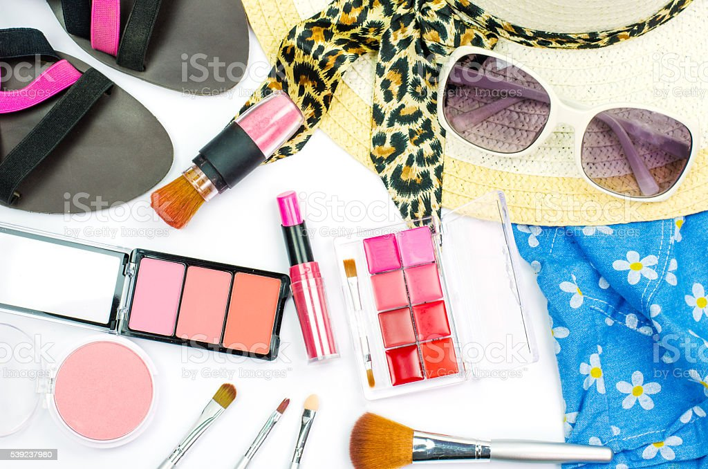 Cosmetics and women's dress and put on a white background royalty-free stock photo