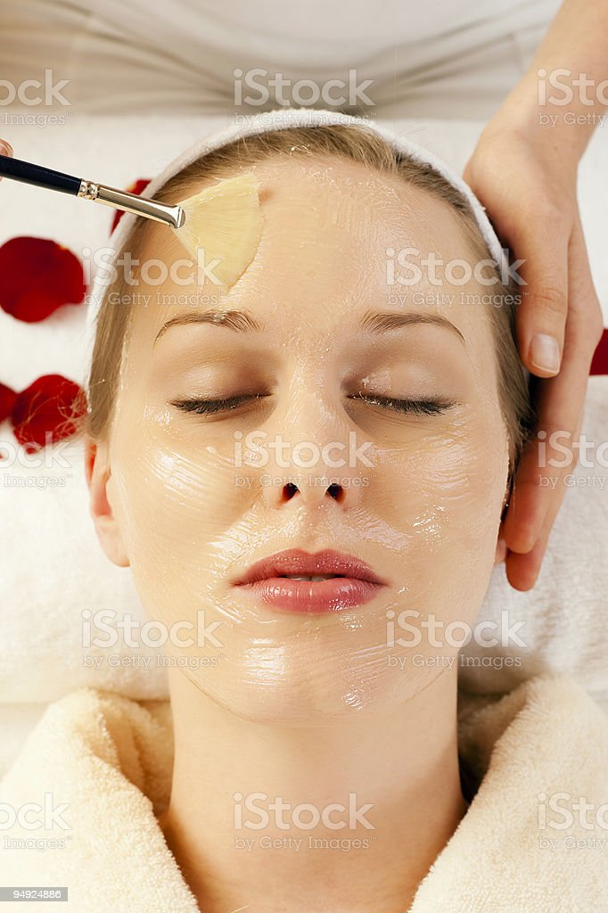 Cosmetics - applying facial mask royalty-free stock photo
