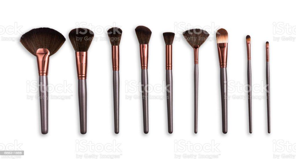 Cosméticos, belleza, brochas de maquillaje en fila - foto de stock