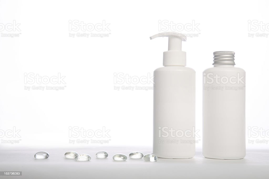 Cosmetics bottles for multiusage with glass crystals royalty-free stock photo