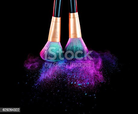 istock Cosmetics brush and explosion makeup dust powder 629264322