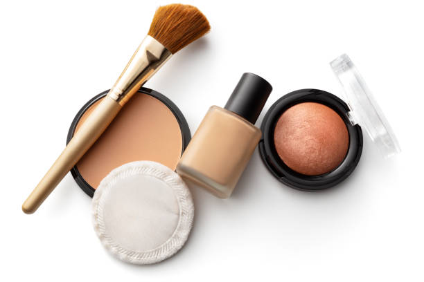 Cosmetics: Foundation, Blush, Face Powder and Makeup Brush Isolated on White Background stock photo