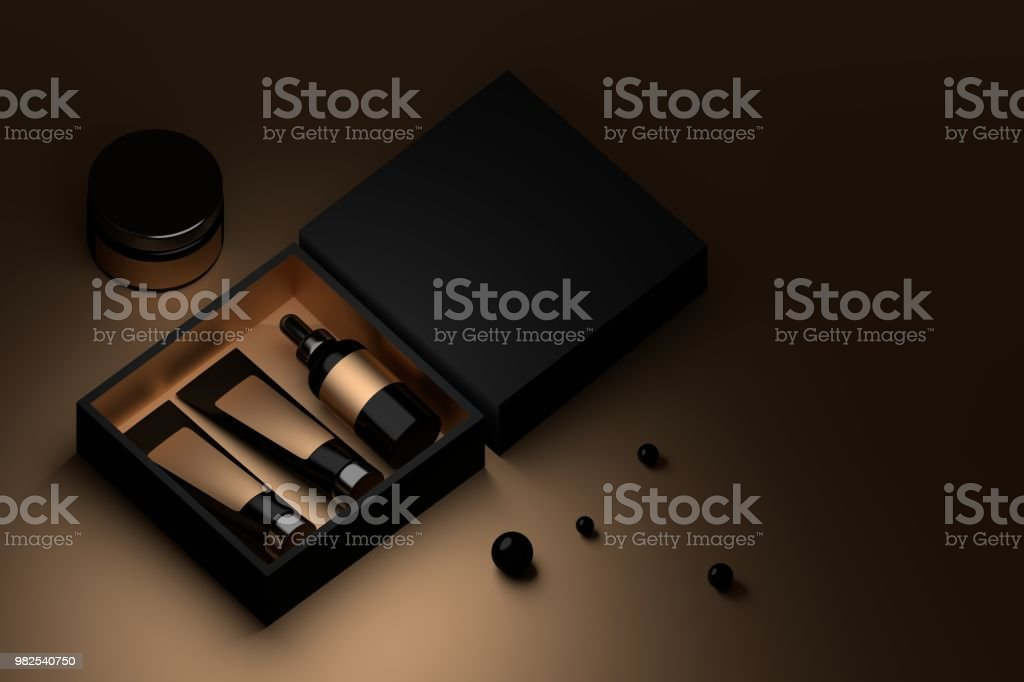 Cosmetics in black and golden box stock photo