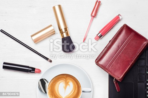 847905020 istock photo Cosmetics laptop cup of coffee cappuccino purse 847904976