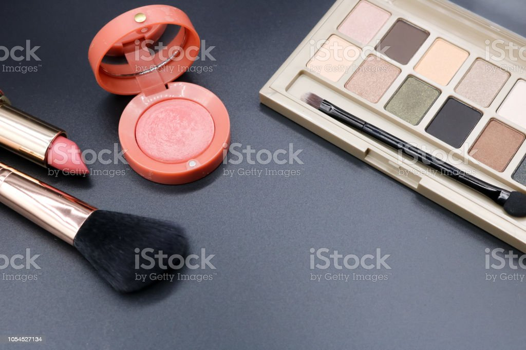 Cosmetics on dark background, beauty concept. stock photo