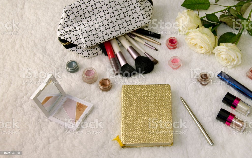 beautiful background, cosmetics with tassels white rose flowers on a...