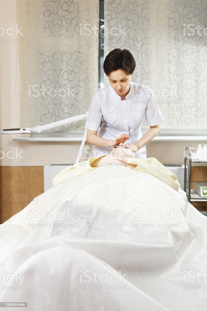 Cosmetologist and patient stock photo