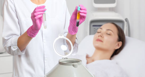 Cosmetologist does prp therapy on the face of a beautiful woman in a beauty salon. Cosmetology concept. stock photo