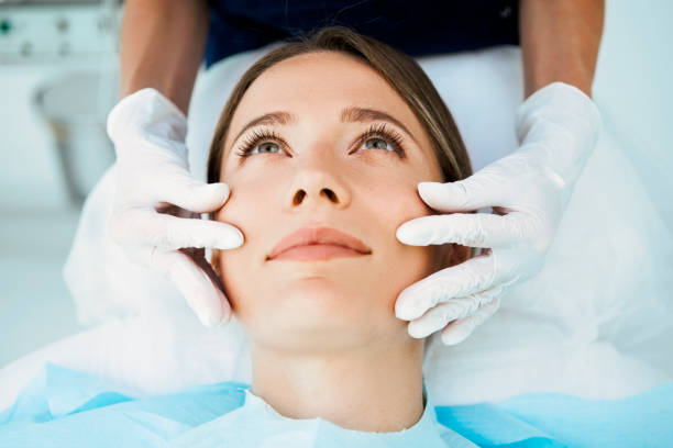 Cosmetologist preparing for facial treatments Cosmetologist preparing to doing cosmetic facial treatments for the young woman dermatologist stock pictures, royalty-free photos & images