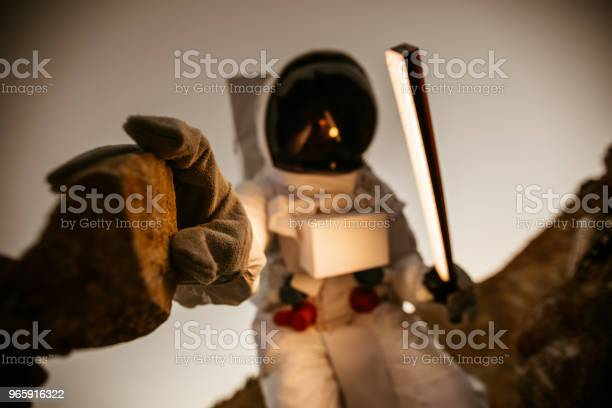 Cosmonaut Picking Up The Rock Stock Photo - Download Image Now