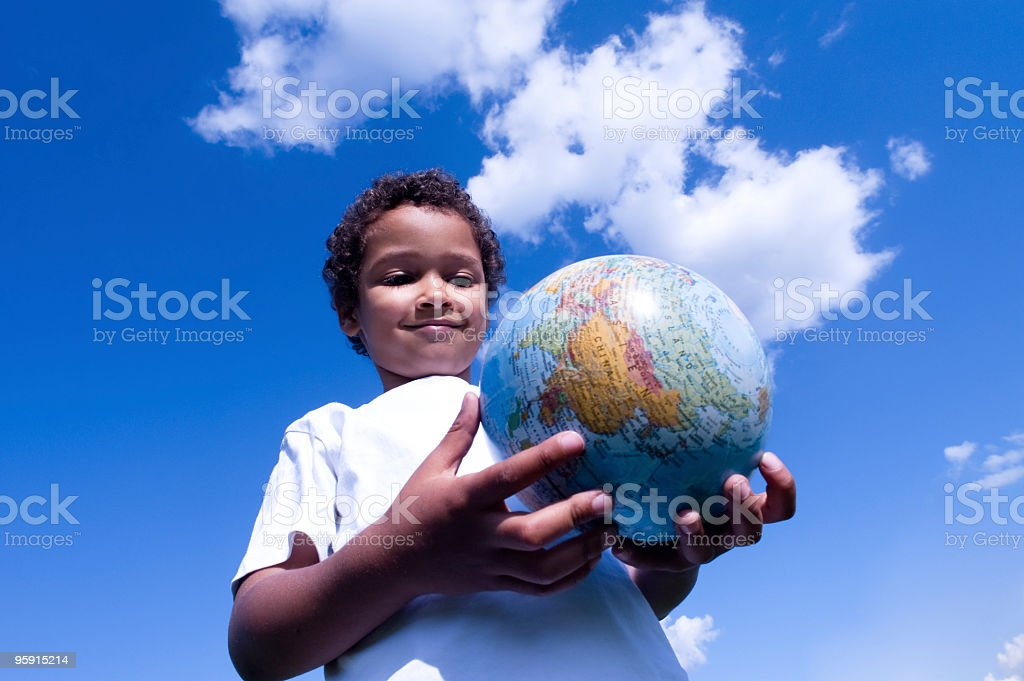 Cosmopolitan child holds the world in his hands stock photo
