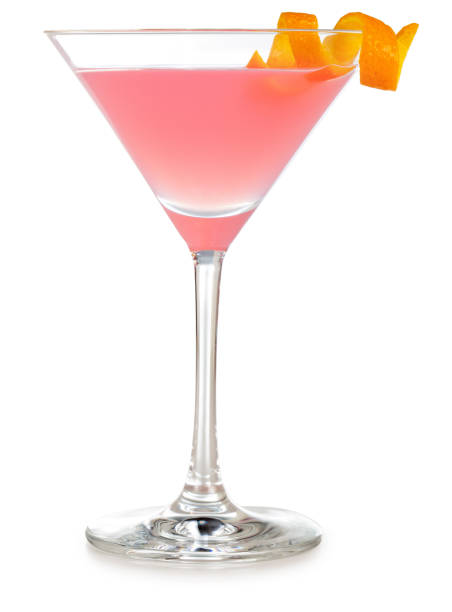 cosmopolitan martini cocktail isolated cosmopolitan cocktail garnished with orange zest isolated on white background martini stock pictures, royalty-free photos & images