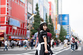 cosplay housemaid walking on street in Akihabara, the most famous cosplay-culture city in Japan and also in the world