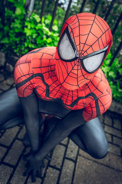 cosplayer dressed as 'spiderman' from marvel - cartoon kostüme stock-fotos und bilder