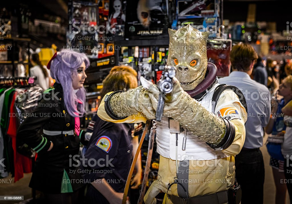 Cosplayer Dressed As The Star Wars Bounty Hunter Bossk Stock