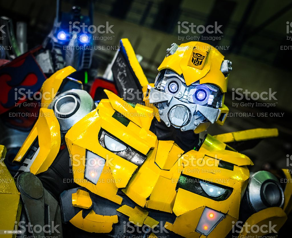 Cosplayers dressed as 'Bumblebee' and 'Optimus Prime' stock photo