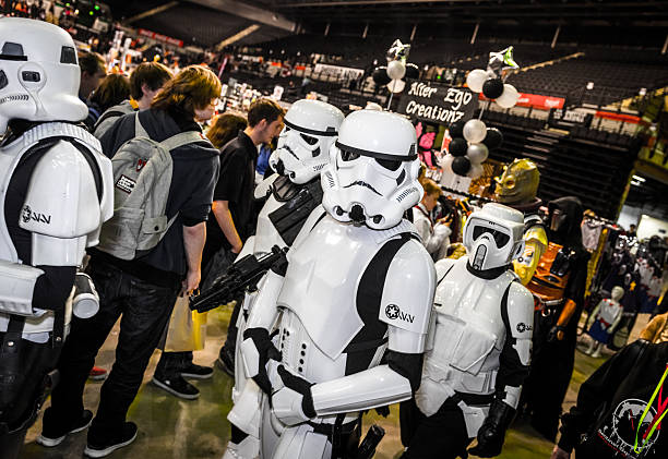 cosplayers dressed as stormtroopers and biker scout from star wars - faschingskostüme star wars stock-fotos und bilder