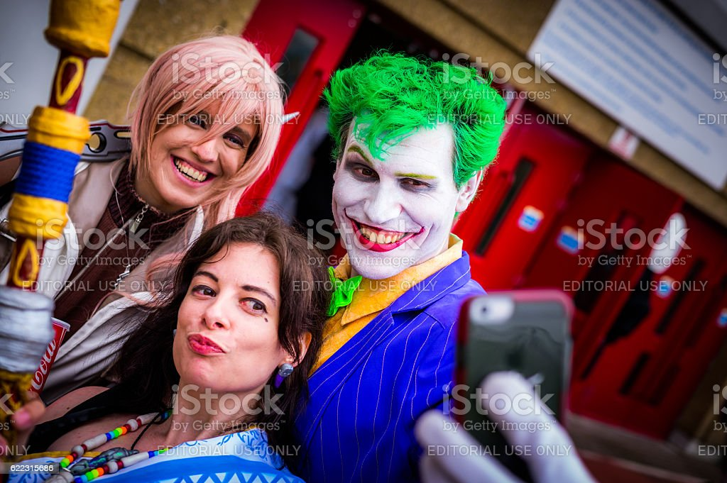Cosplayers pose for a selfie at the Yorkshire Cosplay Convention stock photo