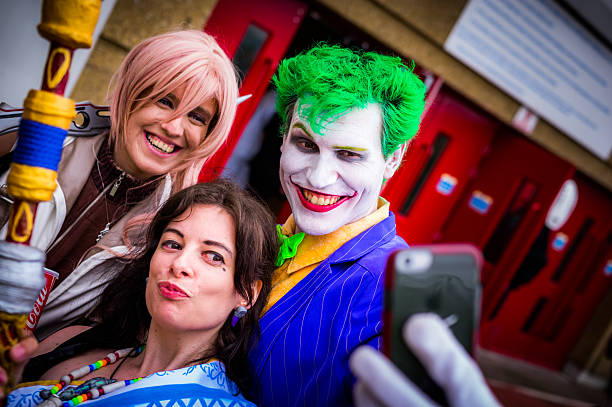 cosplayers pose for a selfie at the yorkshire cosplay convention - コスプレ ストックフォトと画像