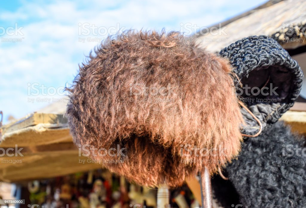 Cossack hat made of sheep's wool on the market. Mouton sheep's wool. stock photo