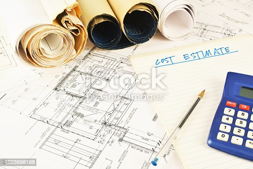 house renovation blueprint, note pad and a calculator