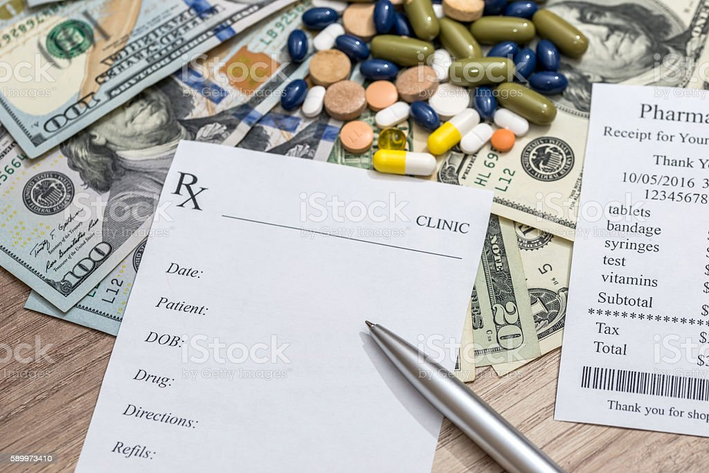 Cost of medicine - blank, money and pen stock photo