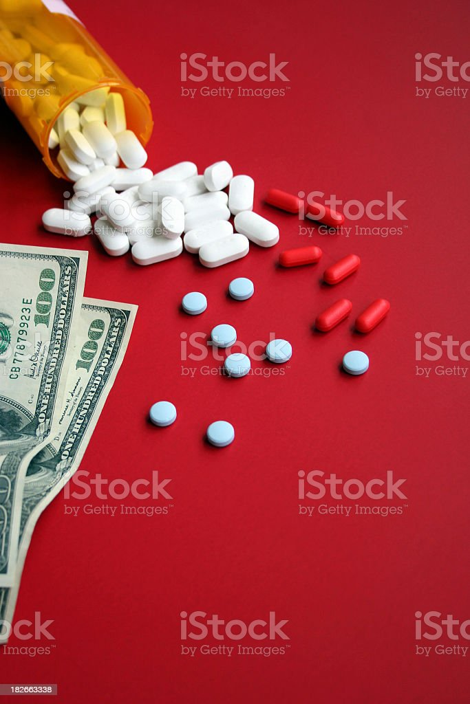 Cost of Prescription Drugs on Red Vertical royalty-free stock photo