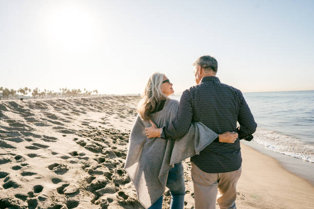 Cost of retirment happiness Senior couple on vacation lifestyles stock pictures, royalty-free photos & images