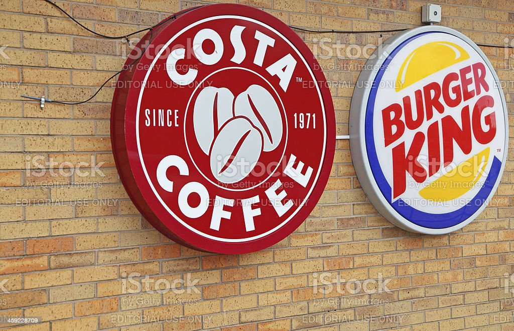 Costa Coffee And Burger King Neon Signs Stock Photo
