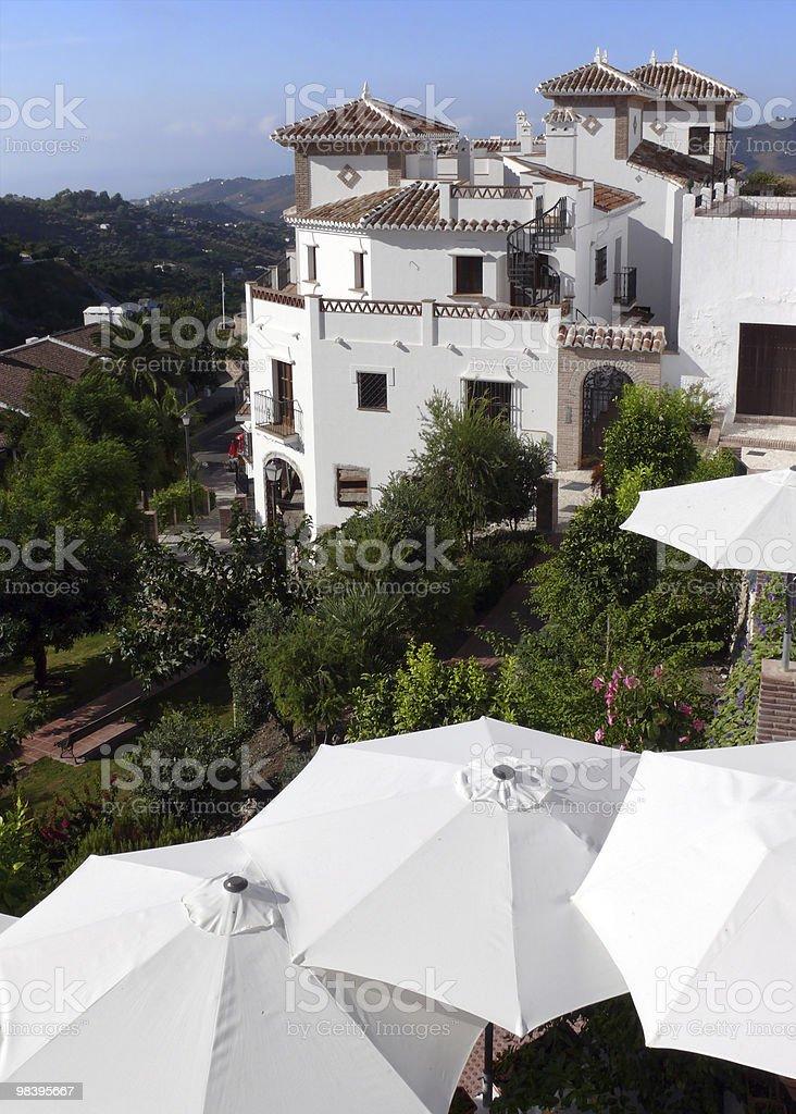 Costa del Sol. Romantic residence & holiday sunshades royalty-free stock photo