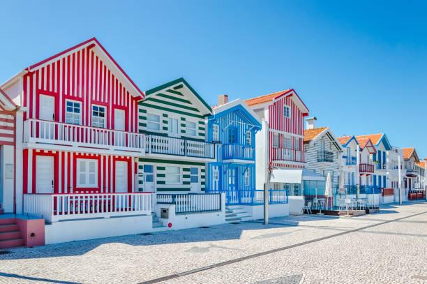 costa nova, portugal: colorful striped houses in a beach village - aveiro imagens e fotografias de stock