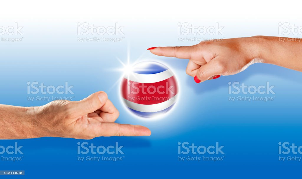 Costa Rica button flag floating between with human hands stock photo