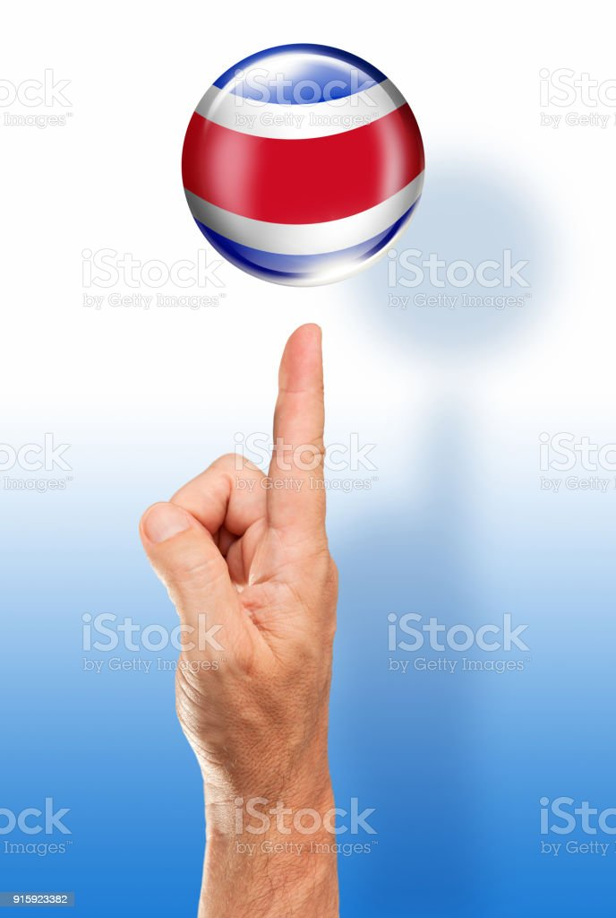 Costa Rica button flag pointing with human hand stock photo