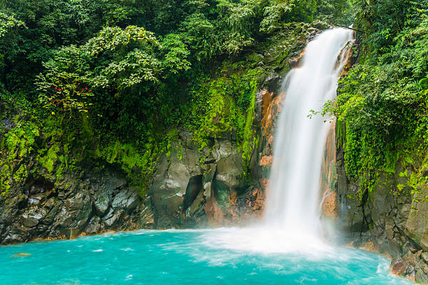 costa rica nature background travel destinations rio celeste - waterfall stock photos and pictures